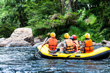 A Group Of Men And Women Are Rafting On The River, Extreme And F