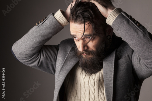 portrait of a sad young man with a beard and mustache Tablou Canvas