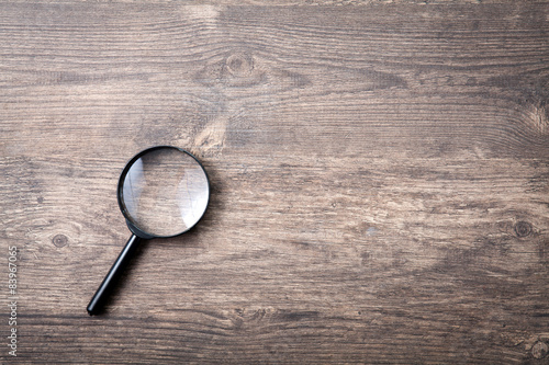 Canvas Print Magnifying glass on wooden table, Search and discover symbol