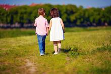 Two Cute Kids Walking Away On ...