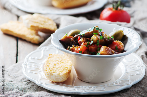 Photo sur Toile Plat cuisine Traditional sicilian dish caponata with eggplant and tomato