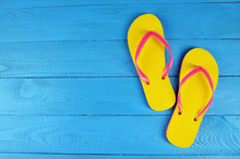 Flip Flops Yellow On Blue Wood...