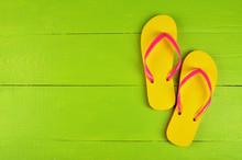 Flip Flops Yellow On Green Wooden Background