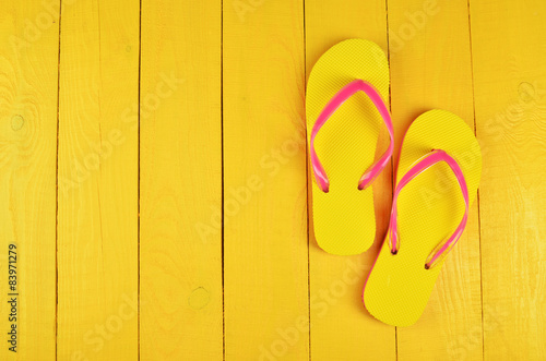 Flip Flops Yellow on yellow wooden background