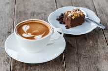 Brownie Cake And Hot Coffee On Wood Table