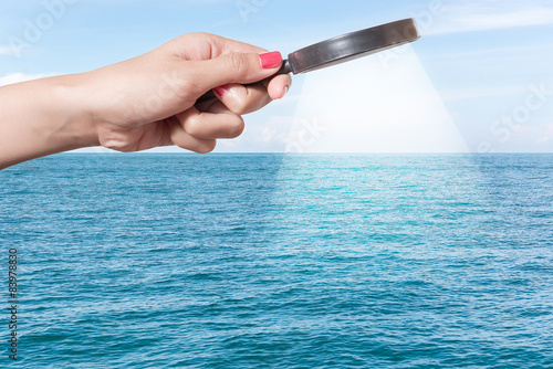 Photo  finding a needle in an ocean