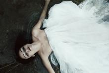 Woman Lying On The Shore In White Dress, Dark Mystery Scene