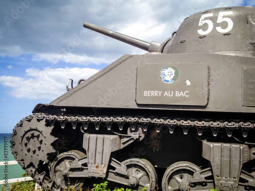 Poster  old tank used in WWII in Arromanches, monument to Allied troops