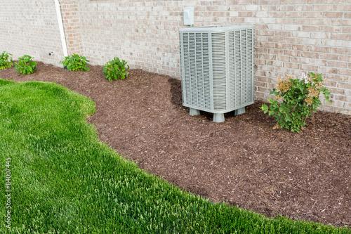 Air conditioner condenser heat pump unit standing outdoors Wallpaper Mural