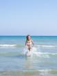 Woman on the beach in Kuta Bali
