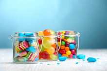 Colorful Candies In Jars On Ta...