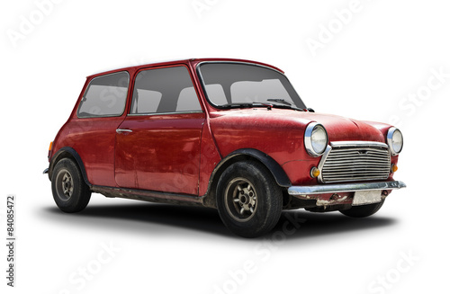 Old rusty car isolated on white © Konstantinos Moraiti