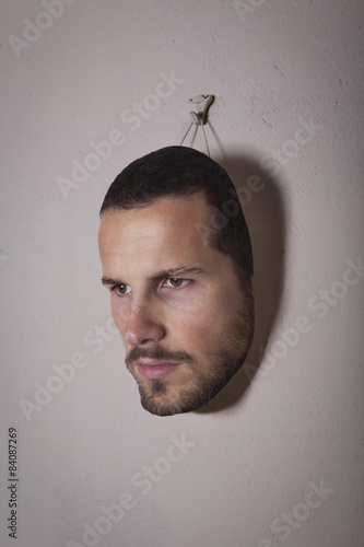 Fotografie, Tablou  male human face mask hang on the wall