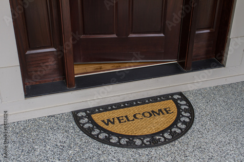 Fotografie, Obraz  Welcome door mat with open door