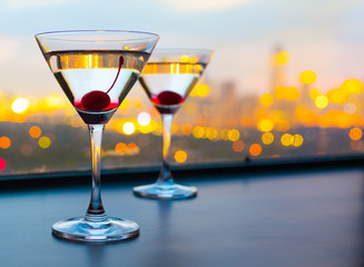 Cocktail glasses with city view