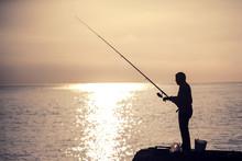 Man Fishing At The Morning.