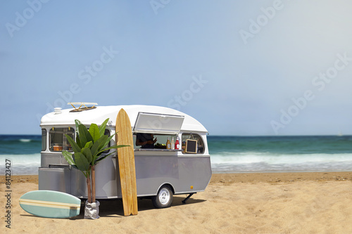 Fényképezés Food truck caravan on the beach