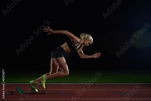 woman  sprinter leaving starting blocks Canvas-taulu