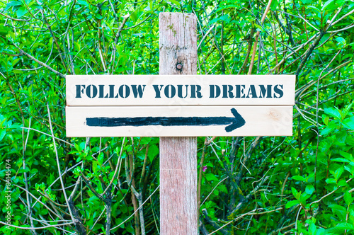 Photo  FOLLOW YOUR DREAMS Directional sign