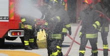 Firefighters With The Fire Extinguisher During A Practice Sessio