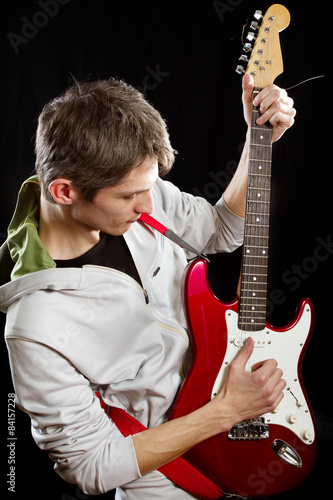 Photo  Man With The Guitar