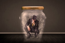 Businessman Inside A Glass Jar...