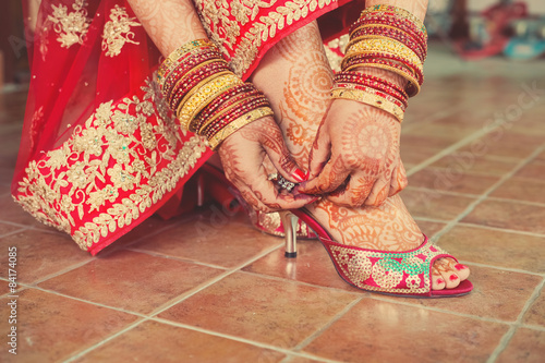 Henna Mehndi Wedding Design On The Feet And Hand Of Red Dressed Up