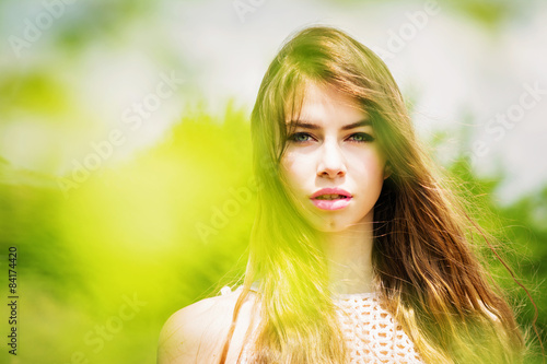 Valokuva  Gorgeous young woman with long hair in nature