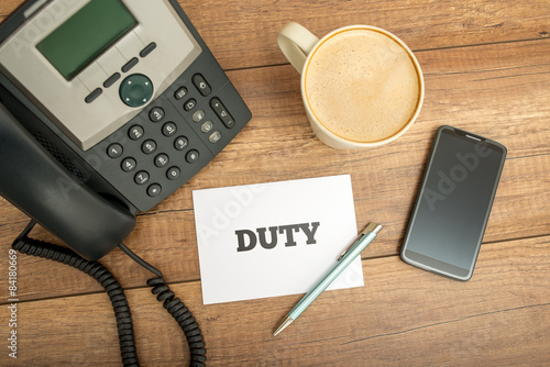 Fotografia, Obraz  White Card with Duty Text on Top of Worktable