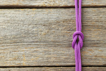 Purple Rope On Grey Wooden Background