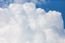 Close Up Of White Fluffy Cumulus Cloud In The Blue Sky