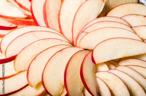 Fototapeta  Apple slices arranged in skillet