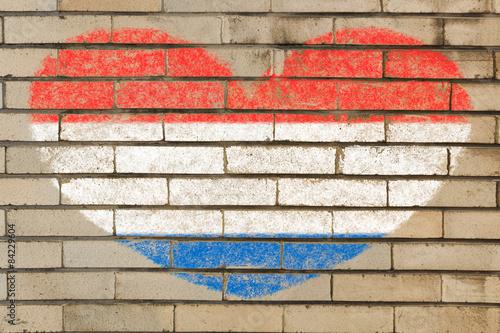 Canvas Print heart shape flag of Netherlands on brick wall