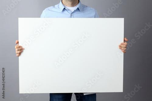 Fotografía  Businessman holding a blank  board