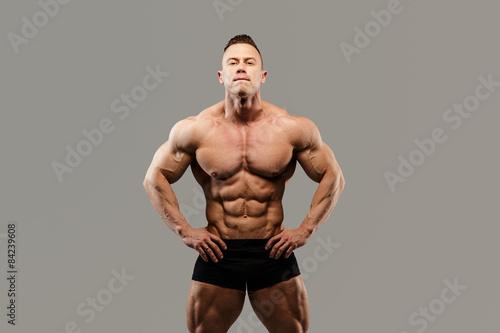 Fotografie, Tablou  Bodybuilders posing in studio