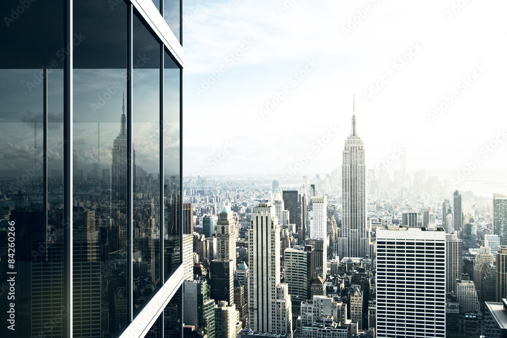Fototapety, obrazy: Cityscape reflected in the glass of an office building