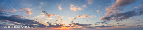 blue panorama of the sky at sunset with clouds and sun