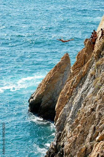 Fotografia, Obraz  Group of cliff divers in free fly, Acapulco, Mexico.