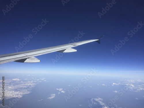 Aircraft Wing above Clouds Canvas Print