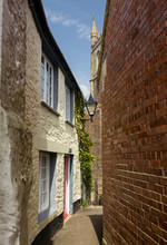 Narrow Alley Or Street Leading...