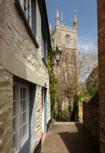 Narrow Alley Or Street Leading To Parish Church