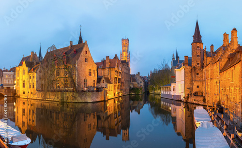 Deurstickers Brugge Bruges, Belgium at dusk.