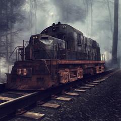 Fototapeta na wymiar Zardzewiała lokomotywa na torach w mglistym lesie