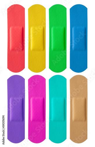 Foto Set of colorful medical bandages isolated on white background