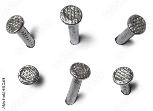 Fotografiet  set of metal nail head isolated on white background
