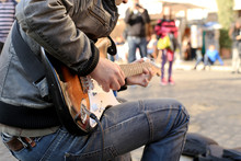 A Street Musician Plays Guitar On The Square