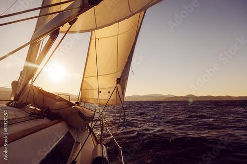 Staande foto Zeilen Sailboat crop during the regatta at sunset ocean