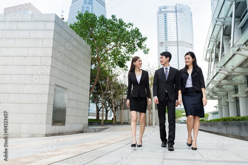 Group of business people walking along the street at outdoor in Poster