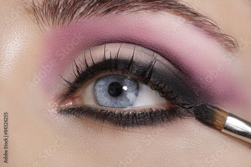 Poster Beauty Close up on eyes , making colorful eyeshadows and eyeliner