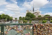 Love Padlocks At Bridge Over River Seine In Paris, France